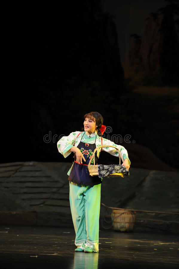 Han young woman- Jiangxi opera a steelyard. Jiangxi opera a steelyard is adapted from a true story: the last century fortys, the protagonists father runs an oil stock image