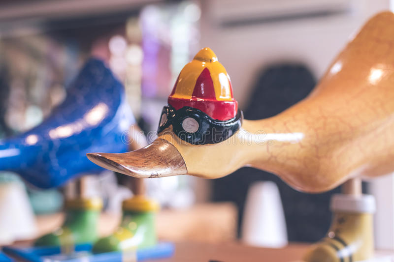 Hancrafted and hand painted funny wooden duck in souvenir shop on a tropical island of Bali, Indonesia. Hancrafted and hand painted funny wooden duck in royalty free stock images