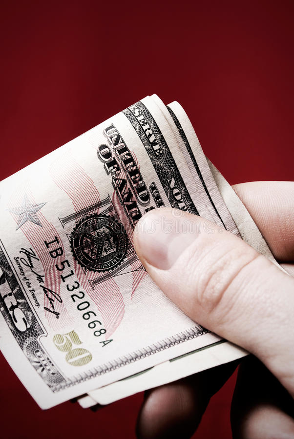 Hand with 50 dollars stock photography