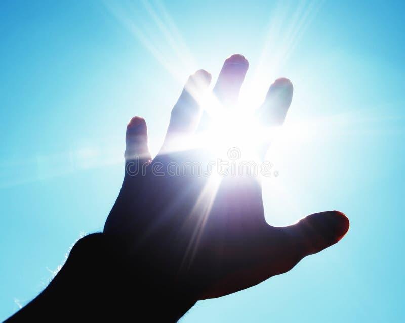 Hand aan zon royalty-vrije stock afbeeldingen