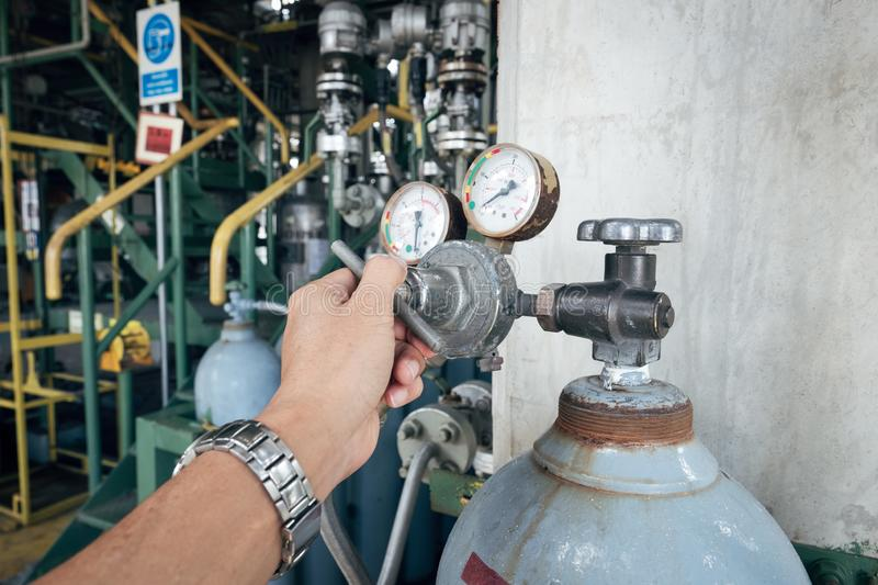 Hand adjust gas pressure use in factory royalty free stock photo