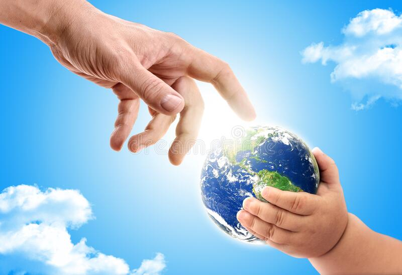 Hand of an adult handing over planet earth to  a baby. Concept of passing the planet to the next generation stock photos