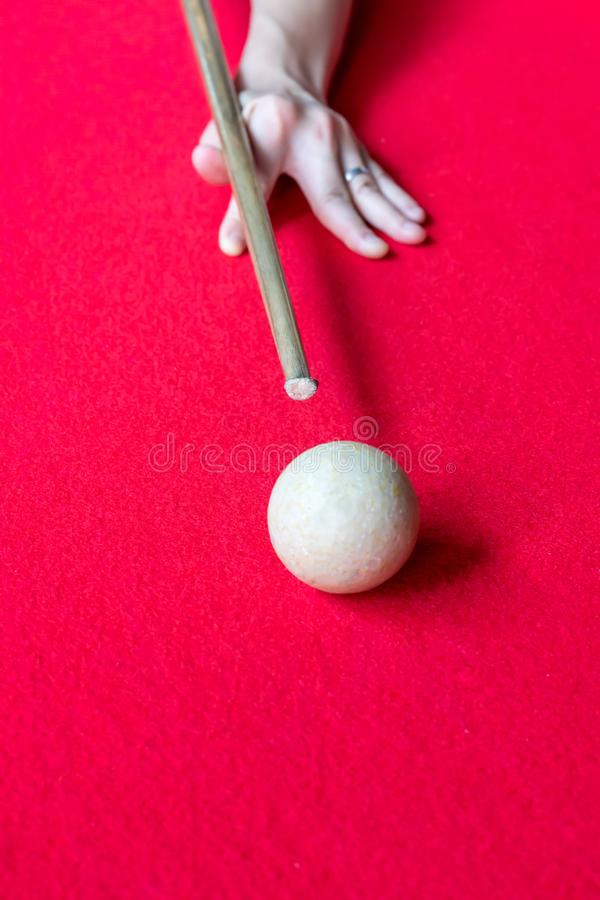 Hand aiming the cue ball on billiard table. stock image