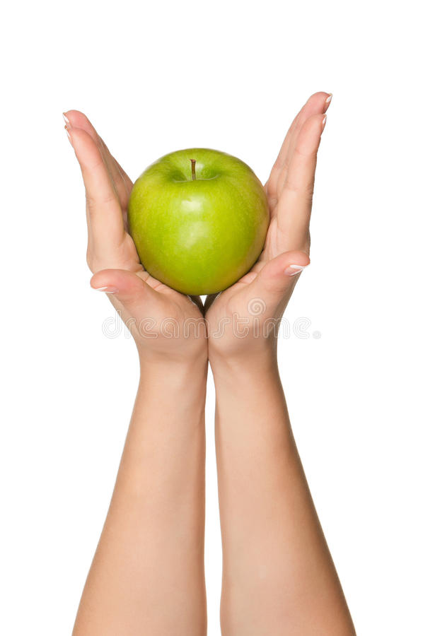 Hand with apple. Woman hands with green apple isolated on white background royalty free stock photos