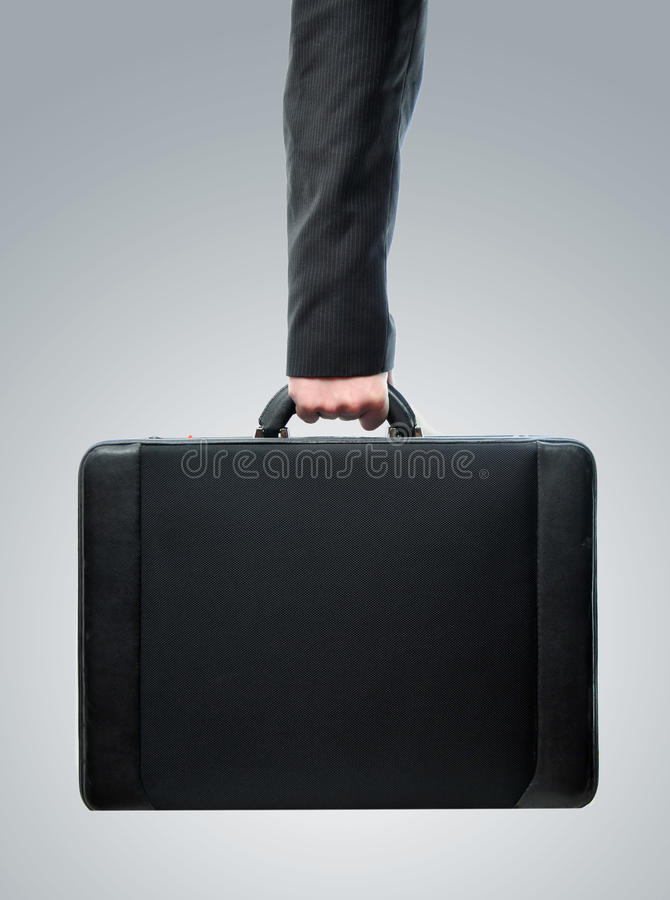 Download Hand And Arm Holding Brief Case Stock Photo - Image: 12363094