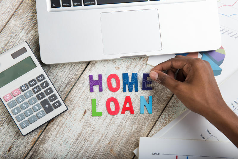 Hand arranging home loan stock image
