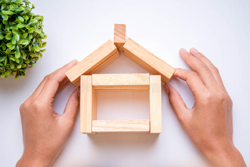 Hand arranging wood block stock photography