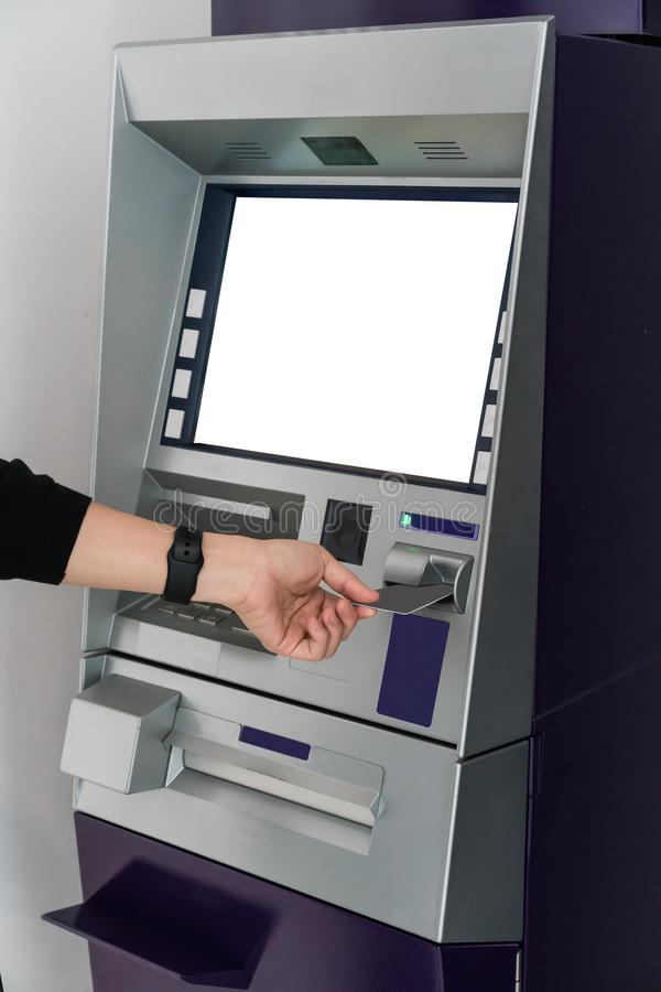Asian lady at atm machine