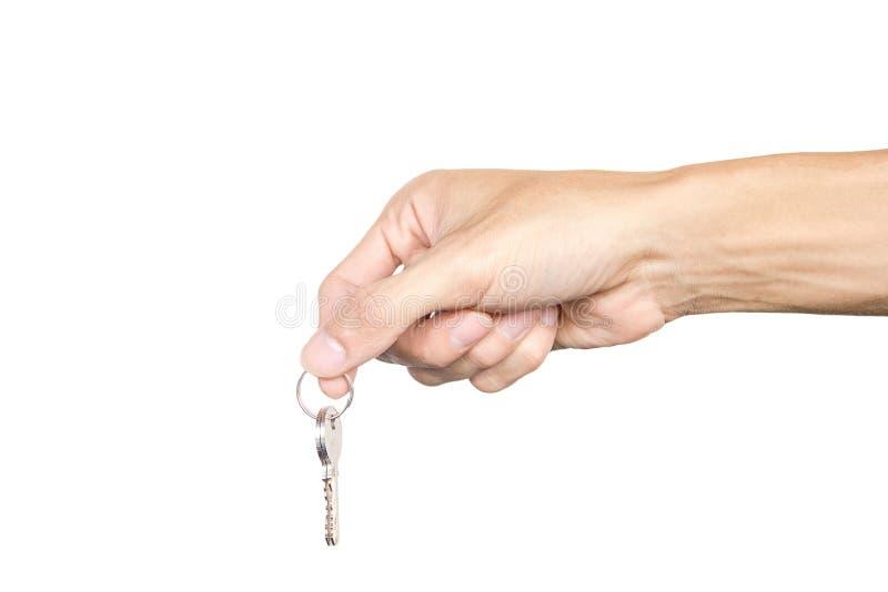 Hand att rymma en tangent isolerad på vit bakgrund den dåliga falska gesthanden betyder nr Snabb bana fotografering för bildbyråer