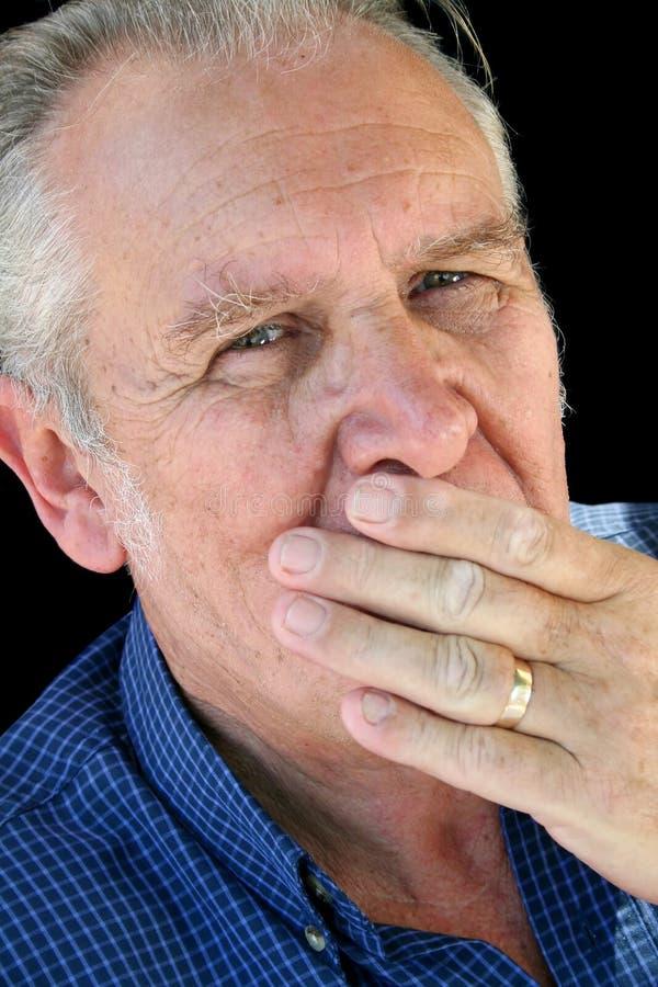 Hand auf Mund-Älterem lizenzfreies stockfoto