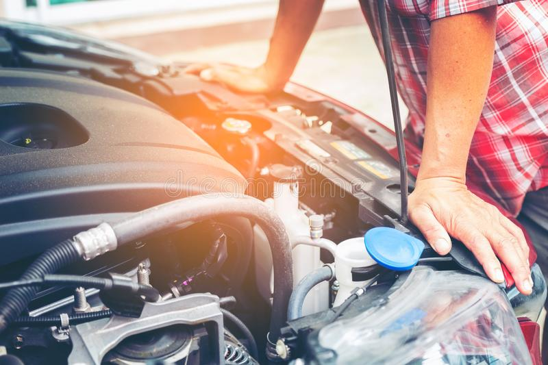 Hand of auto mechanic with a wrench. Car repair mechanic checking car engine in cars service. royalty free stock photography