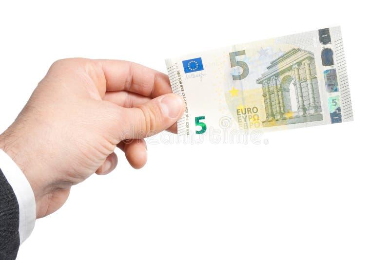 Hand av affärsmannen med euro fem i sedlar royaltyfri bild