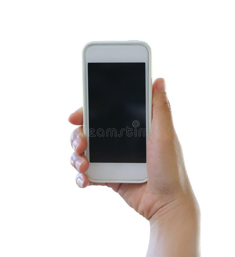 Hand av kvinnan som rymmer en smartphone isolerad på vit bakgrund royaltyfri foto