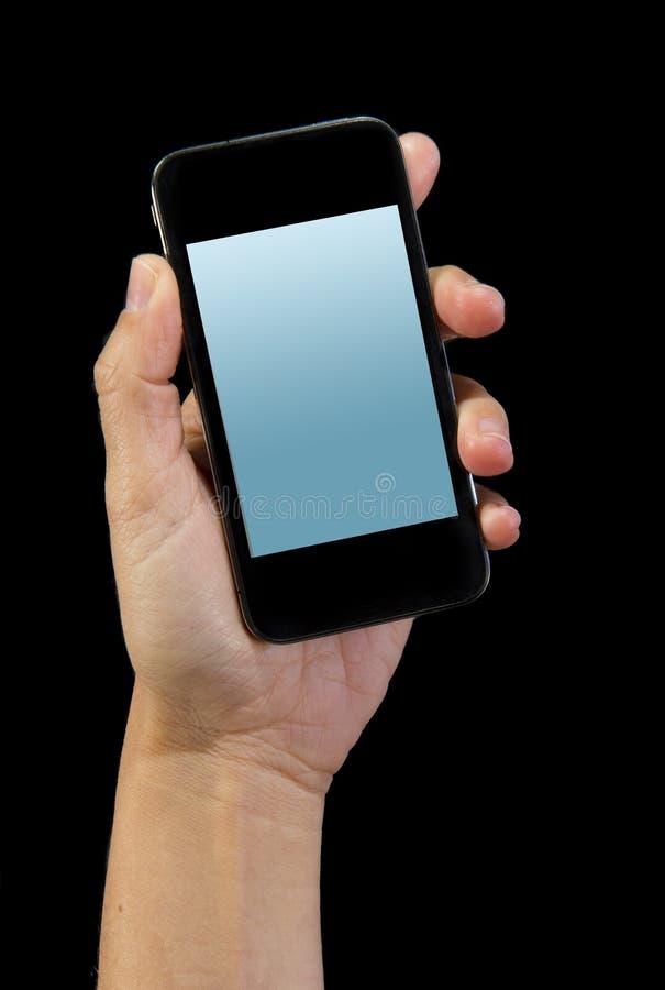Hand av mannen som rymmer den moderna smartphonen eller mobiltelefonen med skärmen för tom skärm som kopieringsutrymme arkivfoton