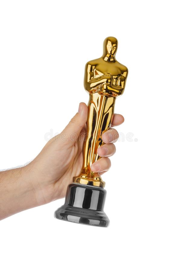 Hand with Award of Oscar ceremony. Isolated on white background royalty free stock photos