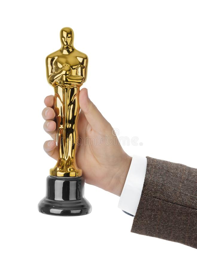 Hand with Award of Oscar ceremony. Isolated on white background royalty free stock photography