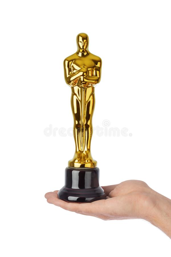 Hand with Award of Oscar ceremony. Isolated on white background royalty free stock images