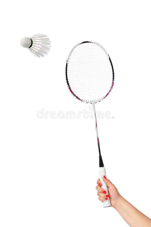 Hand with badminton racket and feather shuttlecock. Isolated on white background stock image