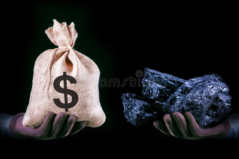 Hand with bag with Dollar banknotes and hand with coal stone. Mining industry concept with dollars and coal. royalty free stock photos