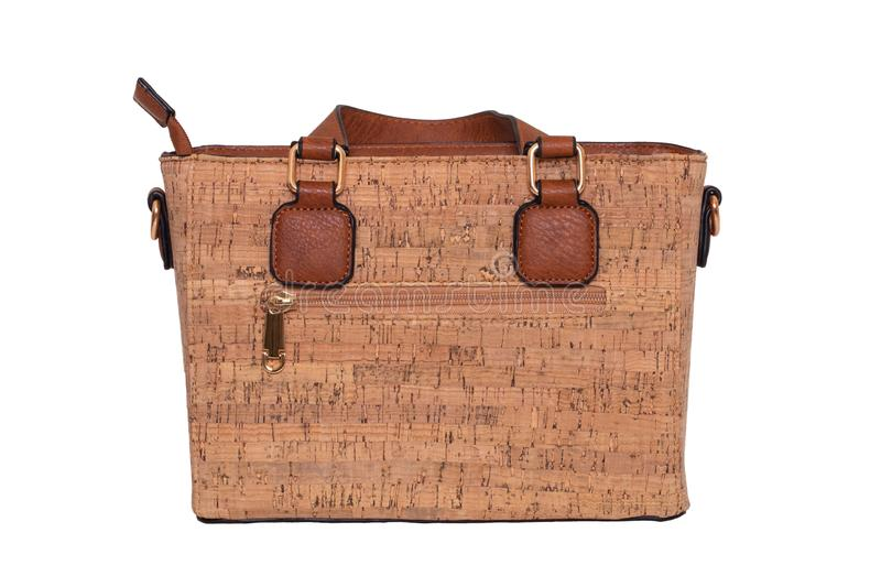 Hand bag isolated. Fashionable brown female luxury women bag  made from oak cork isolated on a white background. Womans stock photo
