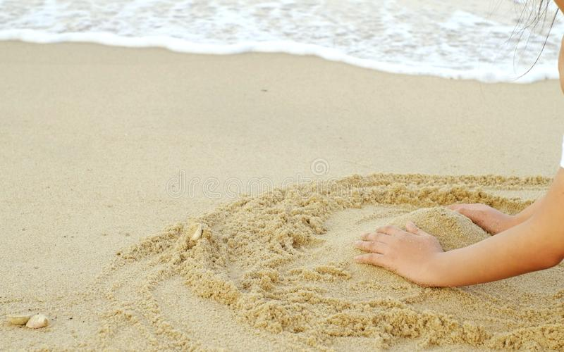 Hand,beach,sandy and sea in holiday. royalty free stock photos
