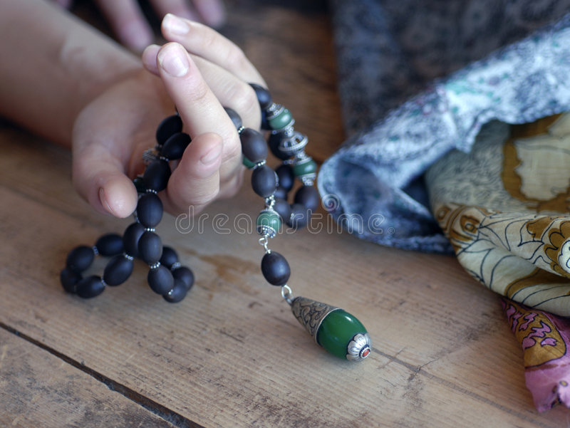 Hand and Beads stock photography