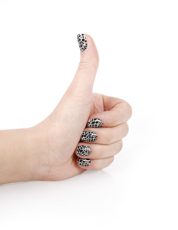 Hand with beautiful manicure show gesture ok stock photography