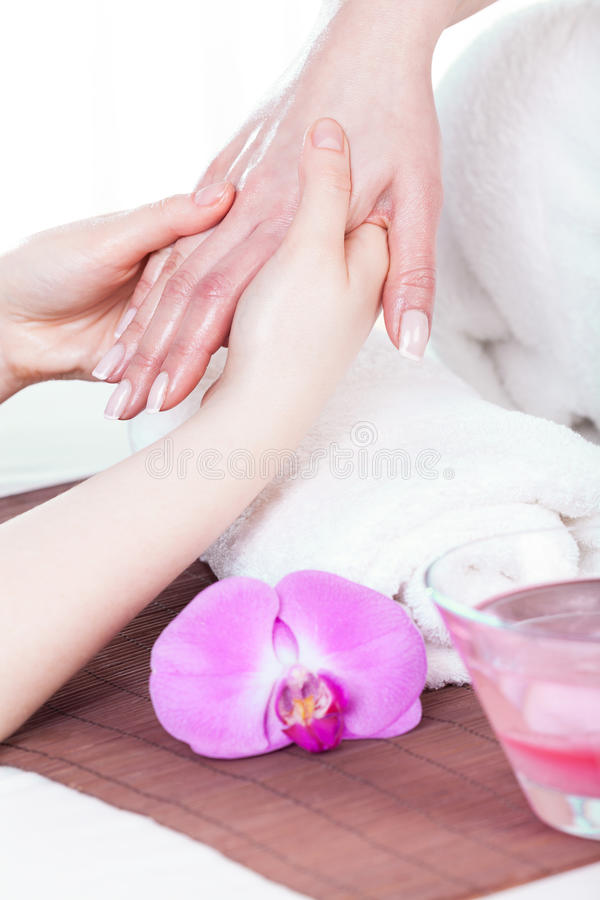 Hand beauty treatment. During manicure session at spa stock photos