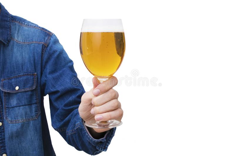Hand with beer glass. Insulated in white stock photography