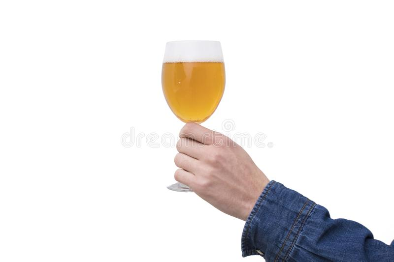 Hand with beer glass. Insulated in white stock photo
