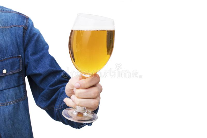 Hand with beer glass. Insulated in white royalty free stock photos