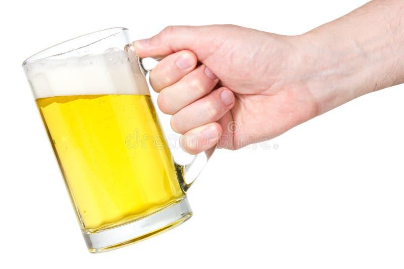Hand with beer-mug royalty free stock image