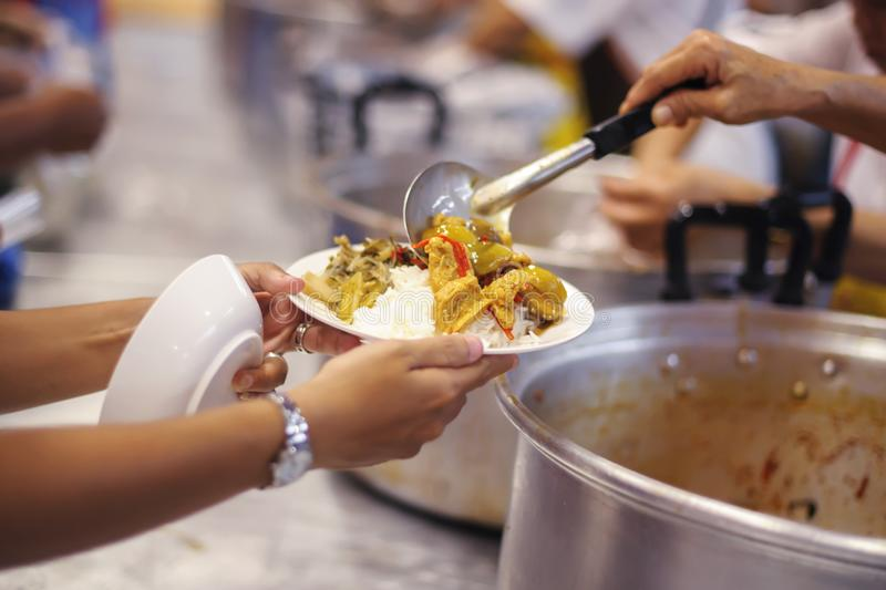 Hand begging for food from the rich`s share : the concept of hope.  stock image