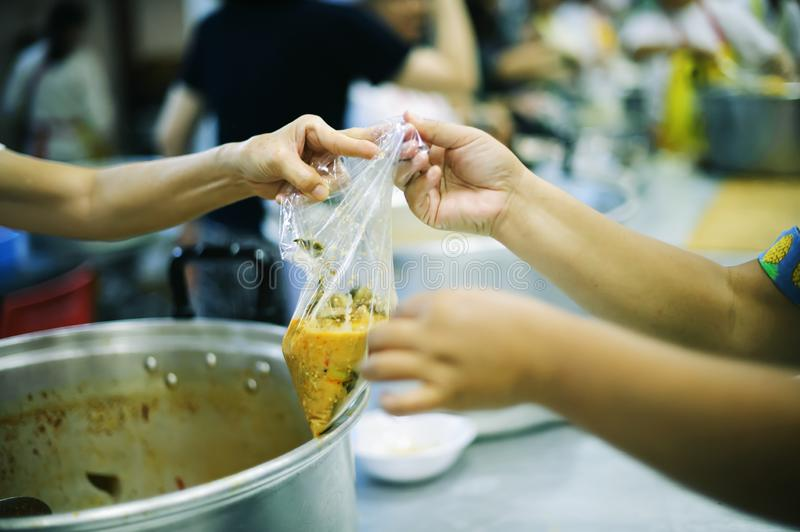 Hand begging for food from the rich`s share : the concept of hope.  royalty free stock photos