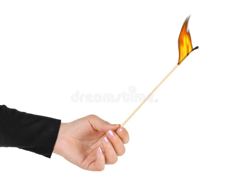 Hand with big burning match stock photo