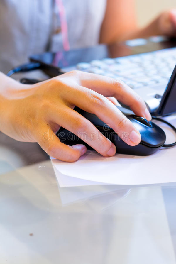 Hand on a black mouse at work royalty free stock photo
