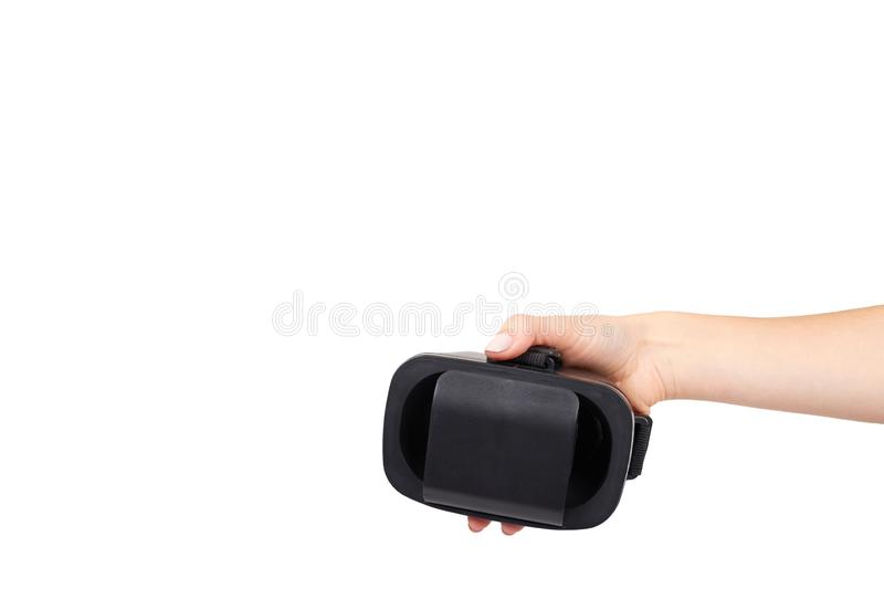 Hand with black plastic VR headset, Virtual Reality mask. Isolated on white background. Copy space template, digital, entertainment, innovation, modern royalty free stock image