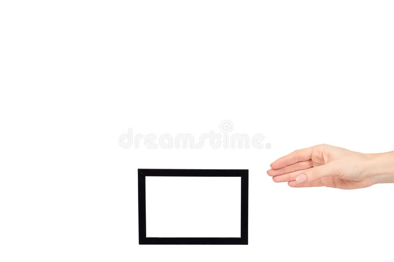 Hand with black wooden frame for photo, copy space template royalty free stock photos
