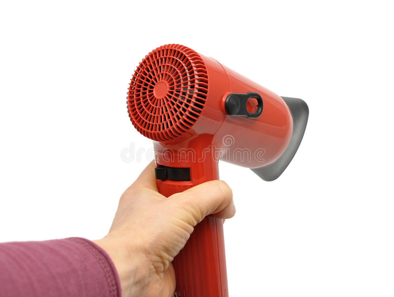 Hand with blow-drier stock photo