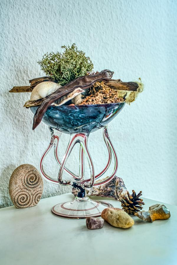 Hand blown glass decorated with natural souveniers stock photos