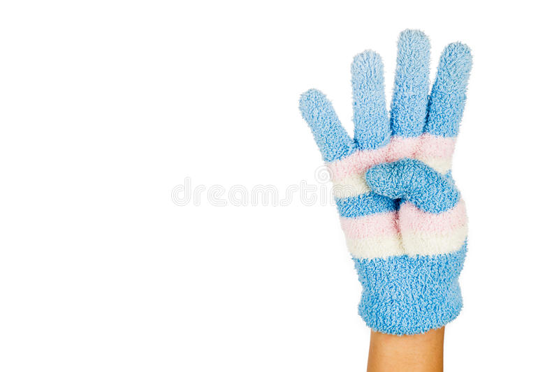 Hand in blue winter glove gesture number four against white back royalty free stock photos