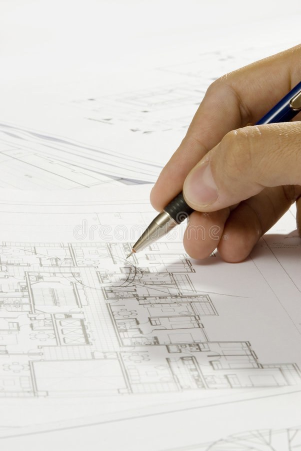 Hand and blueprint royalty free stock images