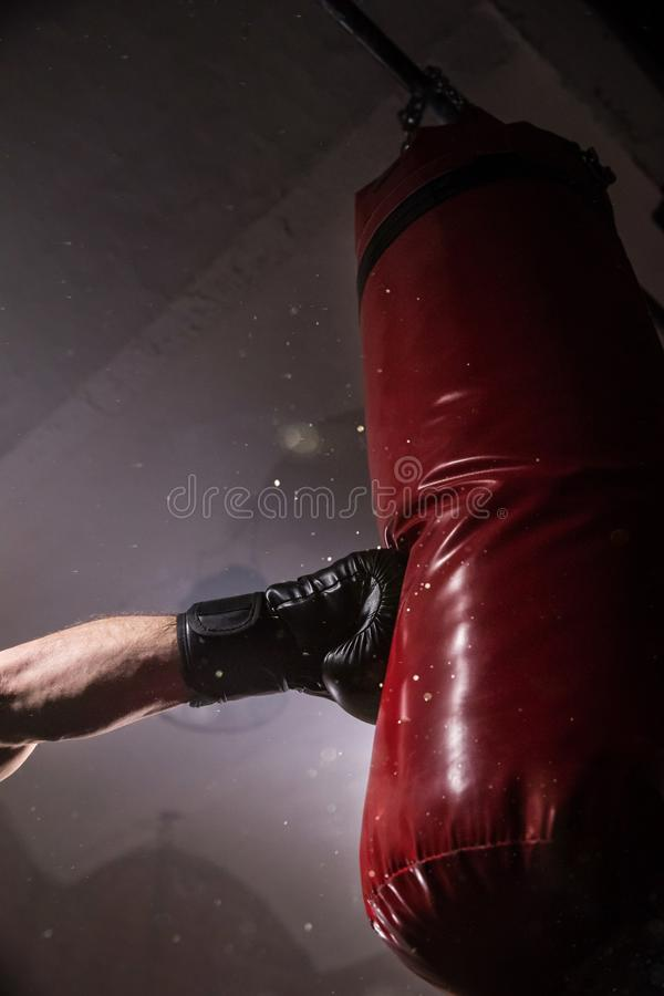 Hand of boxer at the moment of impact on punching bag. stock images