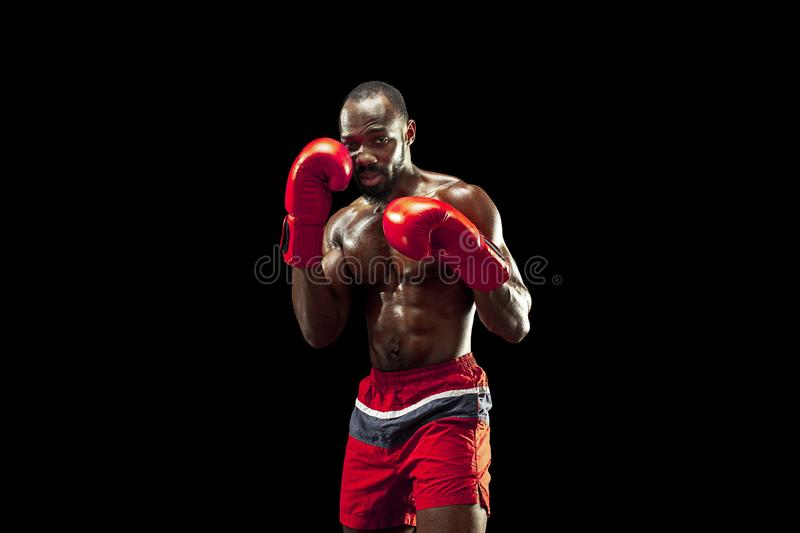 Hand of boxer over black background. Strength, attack and motion concept stock photo