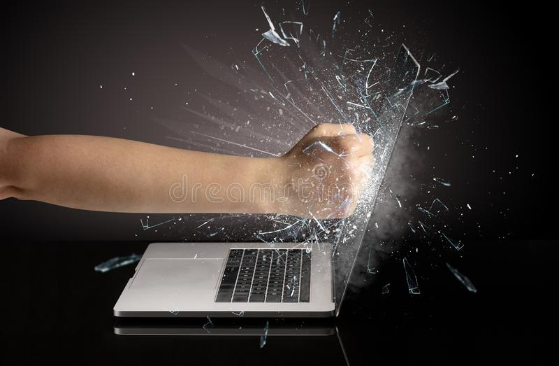 Hand boxing laptops screen. Strong arm boxing laptop screen strongly stock photos