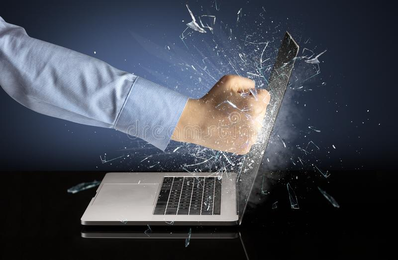 Hand boxing laptops screen. Strong arm boxing laptop screen strongly stock image