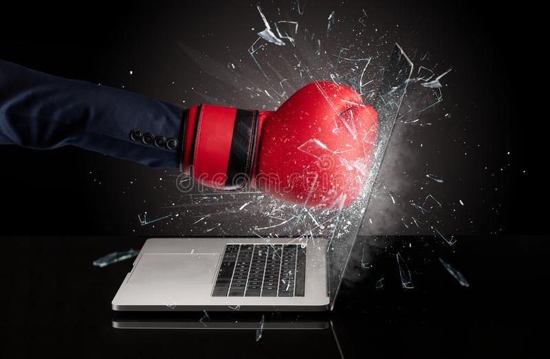 Hand boxing laptops screen. Strong arm boxing laptop screen strongly stock photography
