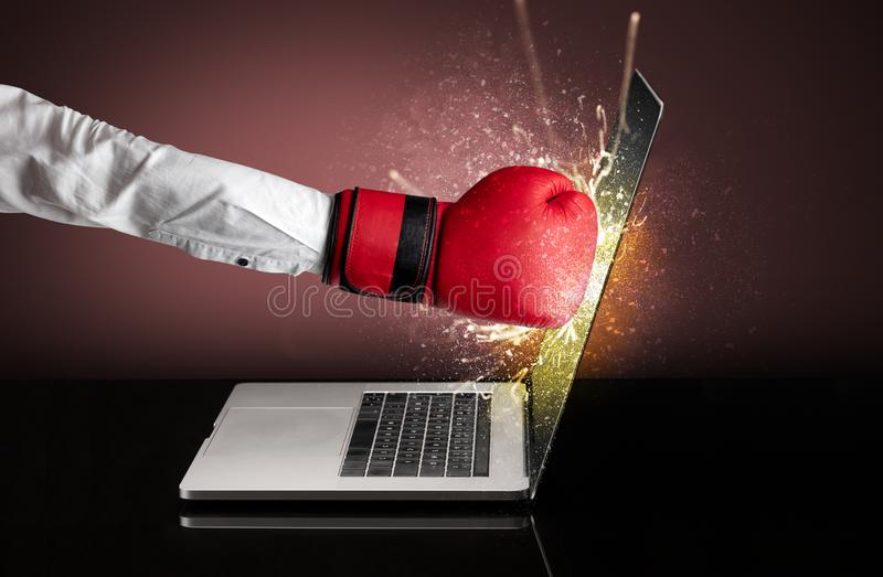 Hand boxing laptops screen. Strong arm boxing laptop screen strongly stock images