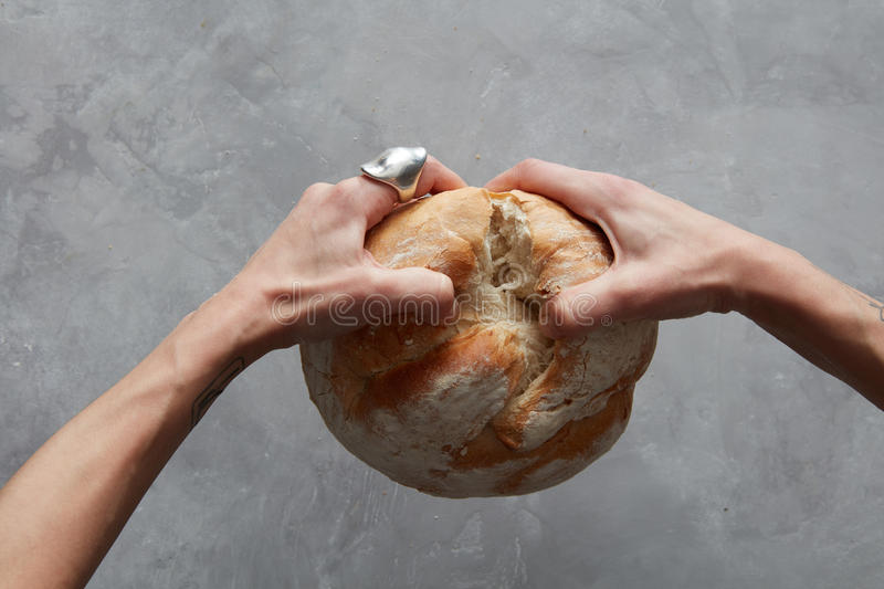 Hand breaking Bread royalty free stock photo