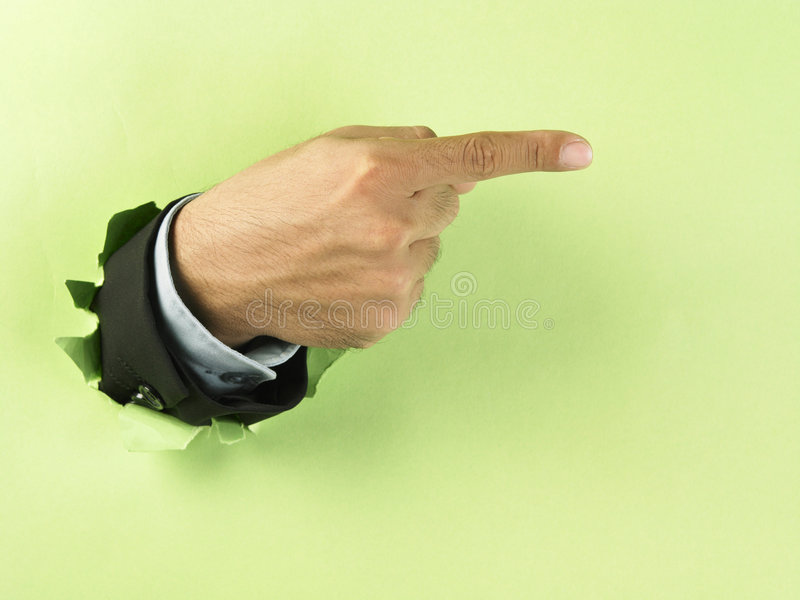 Hand breaking through paper royalty free stock photography